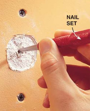 <b>Photo 3: Secure old fasteners</b></br> Bury drywall nails in the wood framing with a nail set. Back out and remove old screws.
