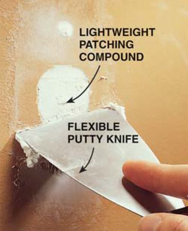 <b>Photo 4: Fill with patching compound</b></br> Fill the damaged area and the holes left by the new screws with lightweight patching compound. Use a flexible putty knife to apply the compound and smooth it. Apply two or three coats, allowing each to dry completely before recoating.