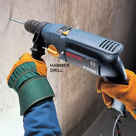 Using a hammer drill when drilling into masonry.