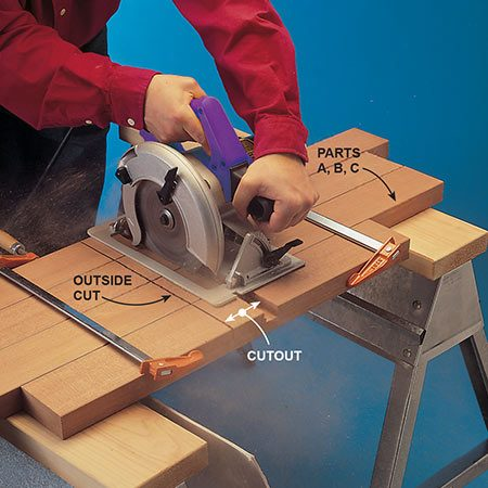 "<b>Photo 1: Dado the base pieces</b></br> <p>Make a wide cutout in the base pieces so they can overlap in an ""X"" shape. First make the two outside cuts, then numerous cuts in between. (You can also use a router or table saw to make these cuts.)</p>"