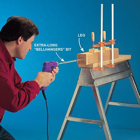 <b>Photo 3: Drill holes in the legs</b></br> <p>Drill long holes through the legs using an extra-long bit. Sight carefully to keep the bit straight, and drill in from both ends.</p>