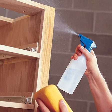 <b>Photo 3: Raise the grain</b></br> <p>Mist the wood with a spray bottle to raise grain, then wipe off excess moisture with a damp sponge. (This step is optional for oil-based poly but very important if you're using water-based stains or clear coats because the water in these will raise the grain, making the surface irregular.) Let the wood dry and lightly sand again with 220- grit to remove any standing grain or burrs.</p>