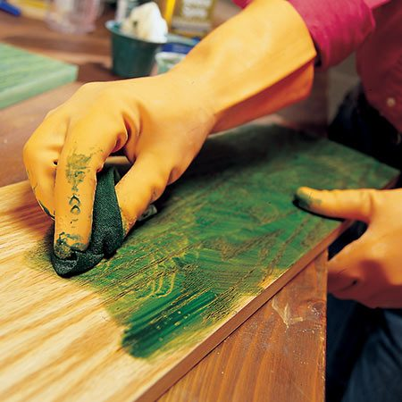 Photo 5 shows how to stain furniture with a rag.
