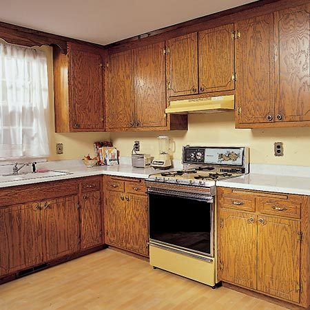 <b>Before</b></br> <p>It looks hopeless, but with new doors and enameled cabinet boxes you can create a whole new kitchen without the huge expense of replacing everything.</p>