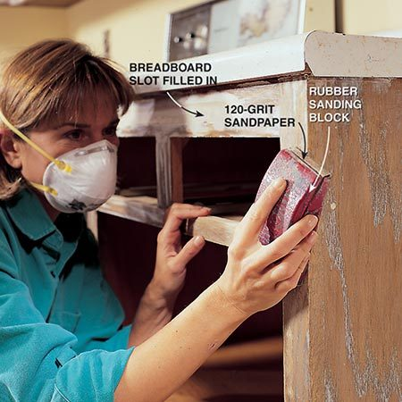 <b>Photo 7: Sand the cabinets smooth</b></br> <p>Sand the spackling compound flush to the cabinet surface with 120-grit sandpaper after it dries. Depending on temperature and humidity, drying time will vary from a few hours to overnight. Wear a dust mask. Look for areas needing additional filling and reapply spackling if necessary. Resand these spots when the spackling dries.</p>