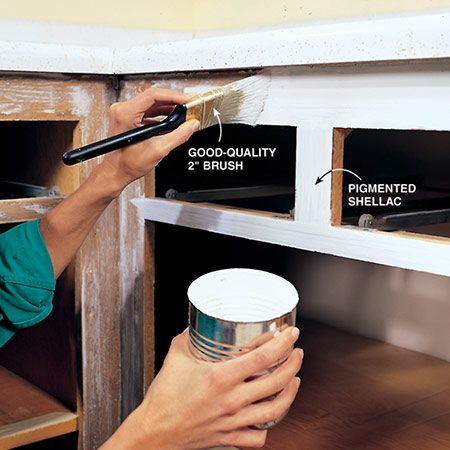 <b>Photo 9: Prime the wood</b></br> <p>Prime the prepared wood surfaces with pigmented shellac sealer. Use a good-quality 2-in. brush. Pour about 1-1/2 in. of your primer into a small can and dip the brush about 1 in. Press the brush against the side of the can to remove excess primer. Don't wipe it across the rim; this removes too much primer. Shellac dries very fast, so work quickly and don't go back over areas that have started to dry. Don't worry if the coverage isn't even; just try to avoid heavy buildup and runs. Clean up spills and the brush with denatured alcohol.</p>