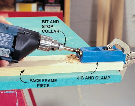 <b>Photo 3: Drill the face frame</b></br> Clamp the jig to the end of a face frame board and bore holes for two pocket screws. Drill the opposite end, and all other face-frame parts that need pocket screw holes. Remember that only one half of each joint needs pocket screw holes. Drill parallel to the grain as shown.
