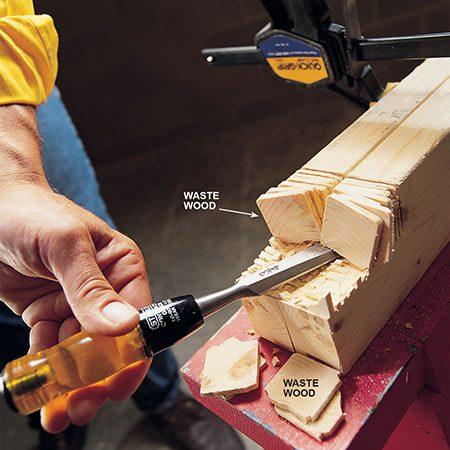 <b>Photo 2: Clean out the notches</b></br> <p>Chisel out the waste wood to define the notches, then cleanly rasp the bottom of each notch.</p>