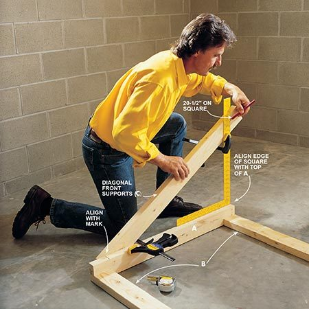 <b>Photo 4: Build the front</b></br> <p>Lay out the diagonal front supports (C) using a framing square. Take a straight 2x4 about 43 in. long and lay it next to the frame. Be sure this diagonal support intersects at 3-1/2 in. from the bottom of the leg (A). Align your square with the top of the back leg so the fat long blade is straight up. Position the diagonal piece so its top edge intersects at 20-1/2 in. on the outer edge of the square, then clamp the temporary diagonal to the back leg (A) and to the square. Mark and cut the intersection where the diagonal support meets the back leg and framing square. Use this piece as a pattern to cut the other support, then align them, drill pilot holes and screw them to the back legs with 3-in. deck screws (Fig. A).</p>