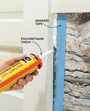 <b>Tape the rough edge</b><br/><p>Lay masking tape along the stone to ensure a crisp, even edge on the rough surface. Then spread caulk over the remaining gap.</p>