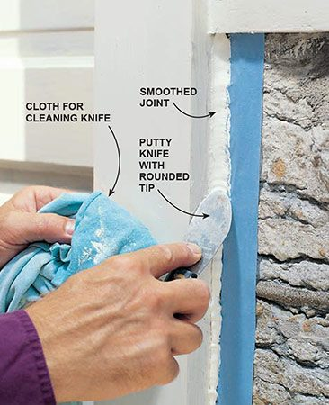 <b>Smooth the caulk</b><br/><p>Caulk doesn't always go in neatly against a jagged surface like this. If it doesn't, smooth the caulk with a round-end tool to shape the joint and ensure good adhesion on the edges. Keep a cloth dampened with thinner handy to clean off excess polyurethane caulk.</p>