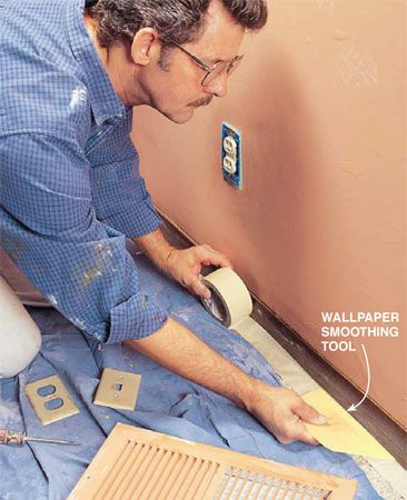 <b>Photo 1: Lay drop cloths and tape floor edges</b></br> Protect the carpet with 3-in. masking tape. Run the tape about 1/2 in. onto the face of the baseboard and push it down under the base with a wallpaper smoothing tool. (Putty knives will cut the tape when you're forcing it down.) Lay dropcloths over the floor and on top of the tape. Remove all switch plate covers, put tape over the outlets and switches and remove all wall-mounted grates. Also cover any hardware, such as doorstops and hinges, and remove knobs and door strike plates.