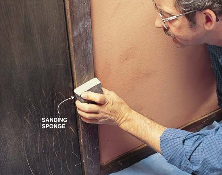 <b>Photo 3: Sand all the trim</b></br> Sand all the woodwork with 100-grit (medium) sanding sponges to slightly roughen smooth, hard surfaces and to dull glossy finishes.