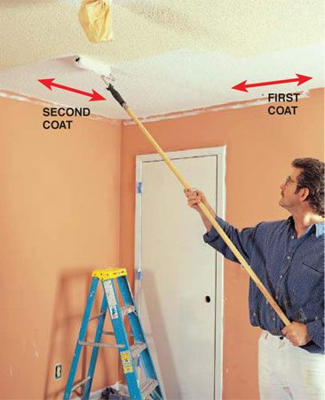 <b>Photo 6: Roll the ceiling</b></br> Roll on ceiling white with a 9-in. wide, 3/4-in. nap roller sleeve on a 9-in. roller frame.