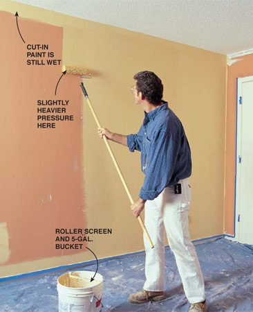 <b>Photo 12: Cut in and roll the walls</b></br> Cut in one wall around woodwork, ceiling, inside corners and electrical boxes with a 3-in. brush. With the cut-in paint still wet, roll that wall with a 9-in. wide, 1/2-in. nap roller on a 9-in. roller frame.