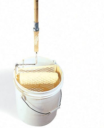 <b>Photo 12A: Bucket/screen combination</b></br> To speed up painting larger rooms, pour 1 or 2 gal. of paint into a 5-gal. bucket and use a roller screen instead of a roller tray.