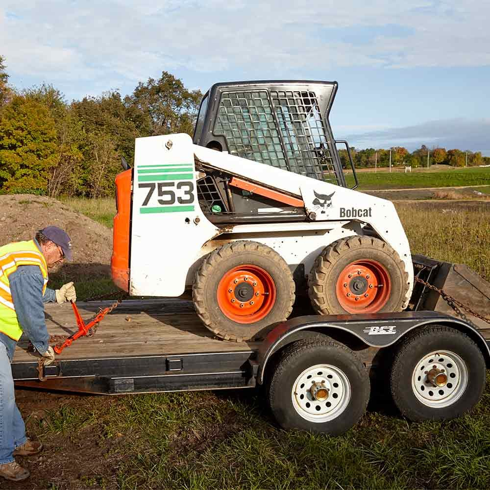 How to Safely Haul a Skid Steer