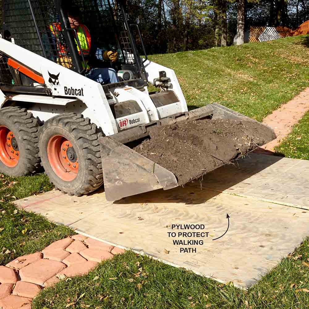 Protect Landscaping from a Skid Steer with Plywood