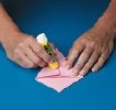 use glue stick on one side of napkin