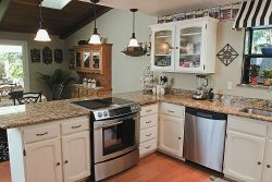 The House Designers Unveil Three New Innovative House Plans - Spacious French Country Kitchen