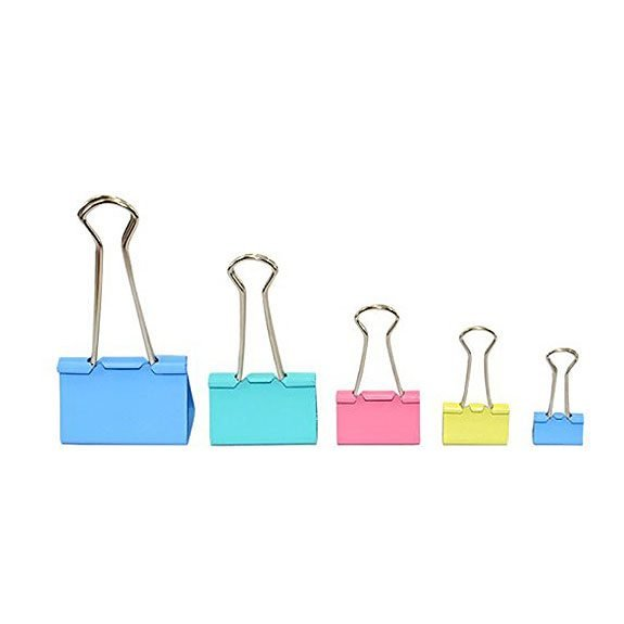 Line up of paper clips from biggest to small and in varying pastel colors