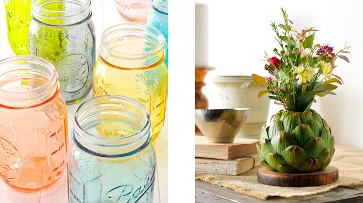 Multiple colored mason jars in a rainbow of colors and an artichoke being used as a vase for a bouquet of flowers