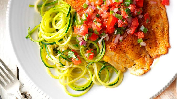 Blackened Tilapia laid on top of Zucchini Noodles