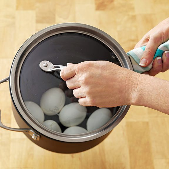 Removing eggs from heat in a covered saucepan