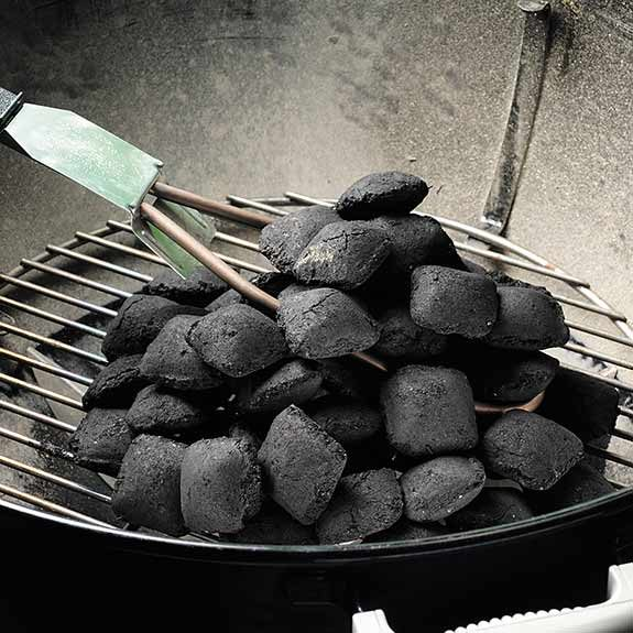 Lighting a charcoal grill with an electric starter.