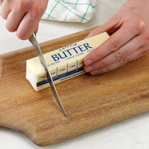 Cutting butter using the measurement markings on wrappers.
