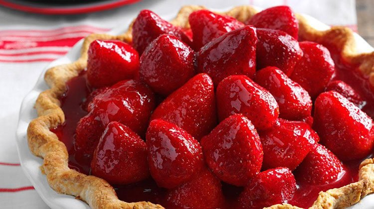 Strawberry pie piled high with whole strawberries shiny with glaze