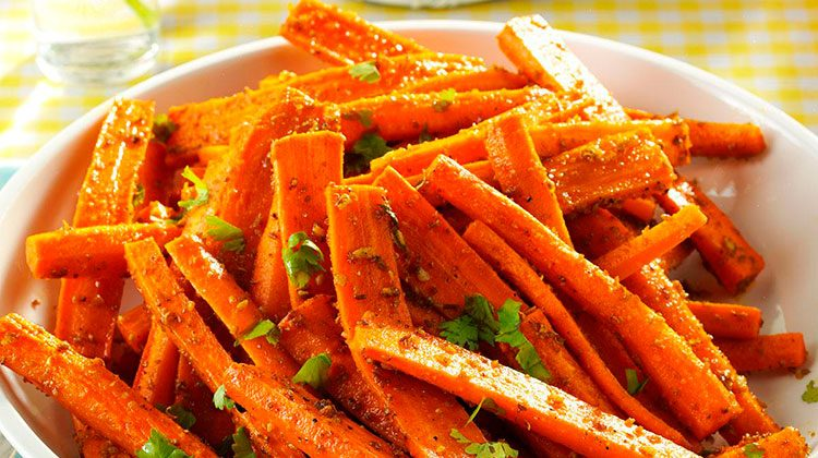 cooked and spiced carrots piled together on a plate