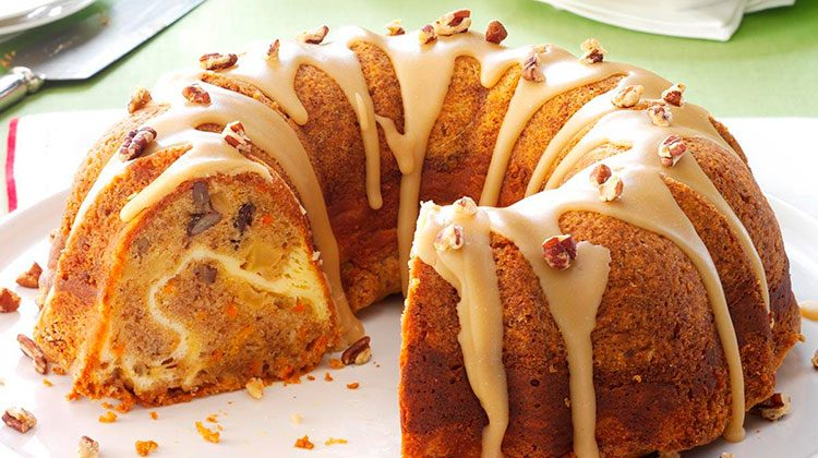 Delicious bundt cake filled with nuts and drizzled with icing