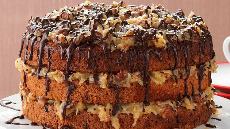 German chocolate cake drizzle in chocolate on a stand