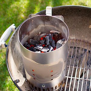 Charcoal in a metal cylinder on the grill