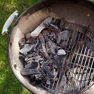 Charcoal now at the bottom of the grill all off to the left side