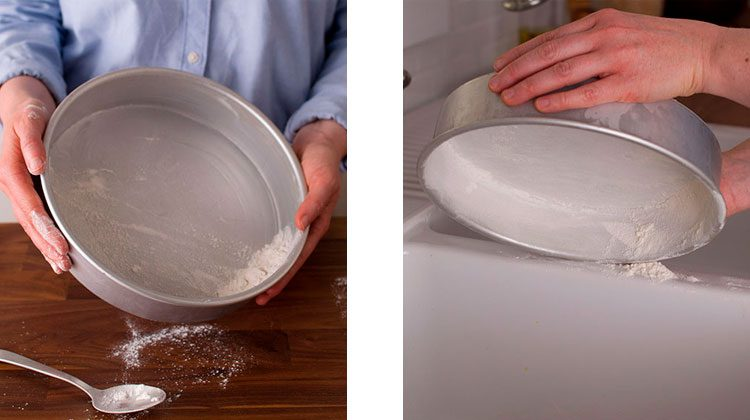 person using a spoon to put flour into a cake pan then shaking out a pan coated in flour over a sink