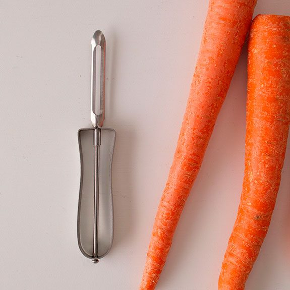 peeler and two un-cut carrots
