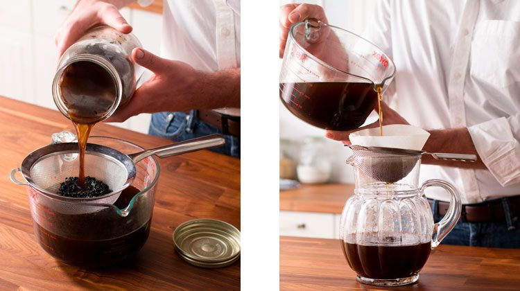 Coffee mixture being poured into a strainer sitting on top of a large glass bowl