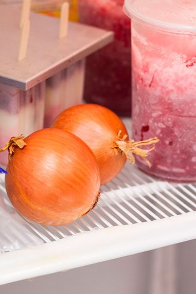 two onions sitting on a shelf into a freezer