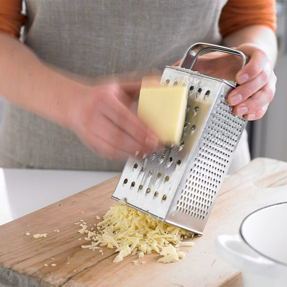 Shredding Monterey Jack cheese for baked mac and cheese
