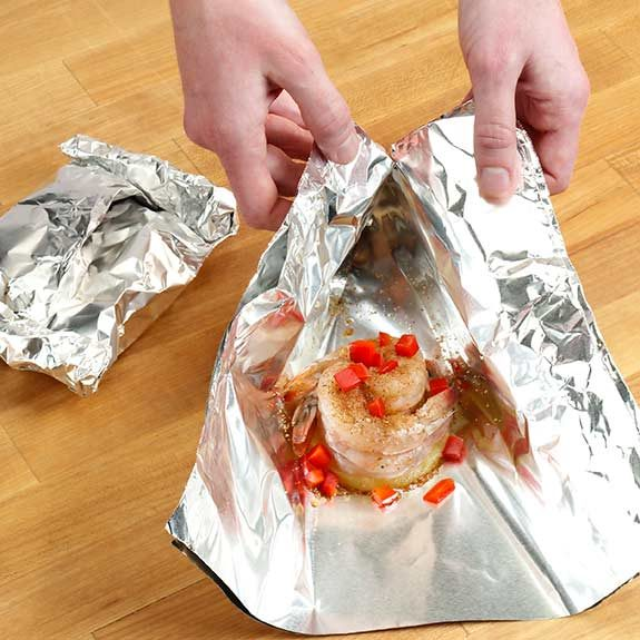 Folding a double thickness of heavy-duty foil over individual servings on the grill