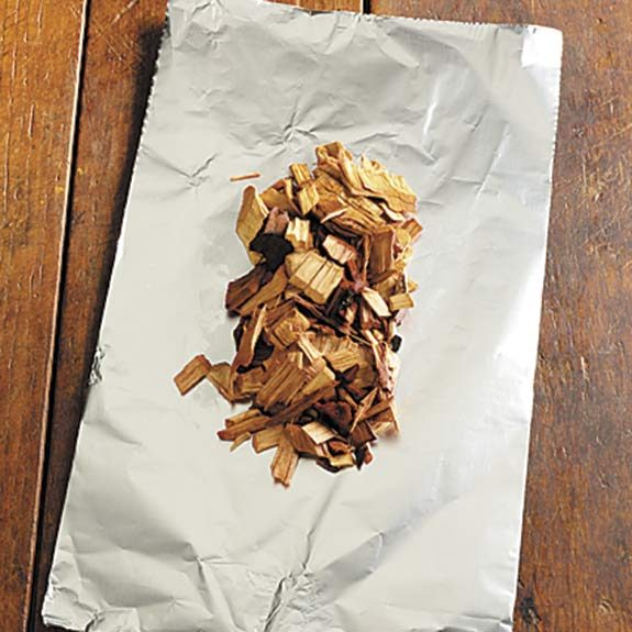 Centering wood chips on heavy-duty foil.