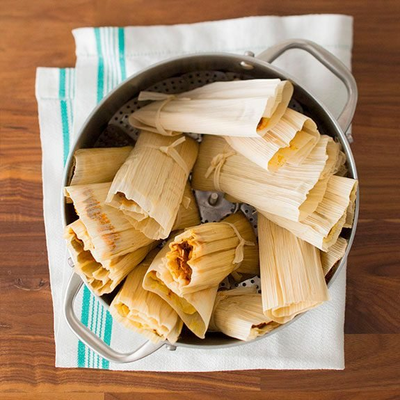 Tamales sitting upright in a stockpot ready to be steamed
