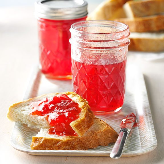 Fresh strawberry freezer jam on a slice of bread