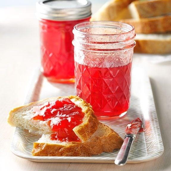 Fresh strawberry freezer jam on a slice of bread