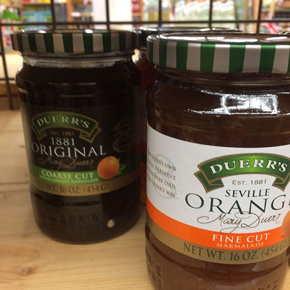 Duerr's fine cut and coarse cut jam jars next to each other on a shelf