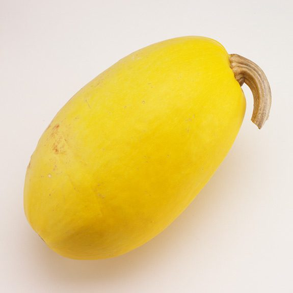 Whole uncooked spaghetti squash with a blemish-free rind