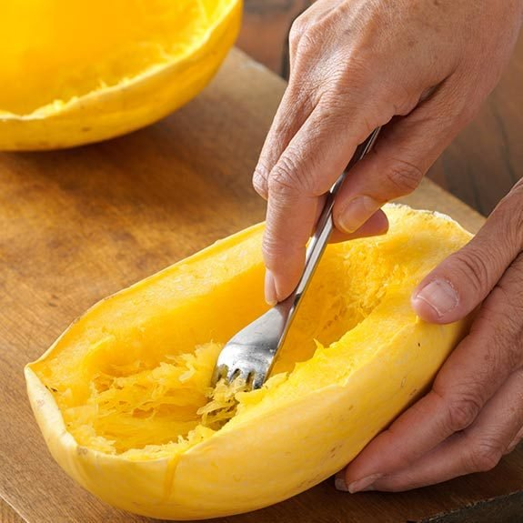 Separating cooked spaghetti squash into strands with a fork
