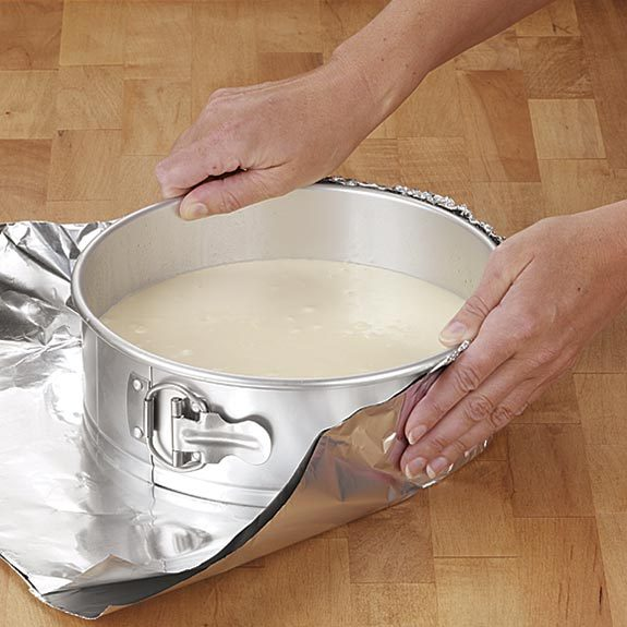 Forming foil around a springform pan before placing in a water bath.